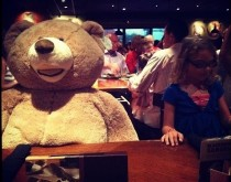 So my sister insisted on the biggest teddy bear Ive ever seen joining us for dinner tonight at Outback