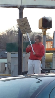 Some guy is protesting winter