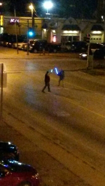 Some people had a light saber fight in the middle of the street