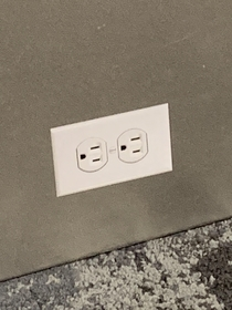 Someone at LAX put stickers on the wall that look VERY convincingly like power outlets