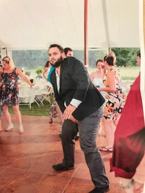 Someone captured the exact moment my brother-in-law realized he split his pants dancing at a wedding