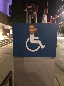 Someone has been putting Drakes head on wheelchair signs