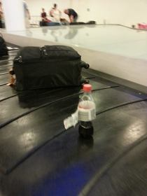 Someone just couldt let his coke go to waste at check-in