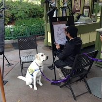 Someone Spotted A Service Dog Getting Caricature At Disneyland