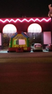 Speaking of bounce houses in strange places heres one I spotted at a strip club in Memphisat pm