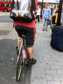 Spotted this guy cycling through London Best bike messenger tattoo ever
