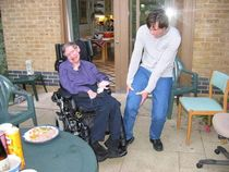 Stephen Hawking running over Jim Carreys foot with his wheelchair