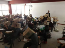 Teacher asks pupils to wear cardboxes on their heads to stop them from cheating