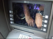 Thanks Reddit juggled the ATM and found a false screen with a man inside trying to write down debit cards