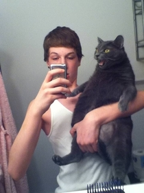 Thats uh not how you hold a cat