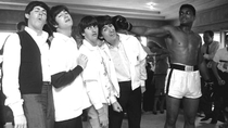 The Beatles all feeling the effects of a single punch from Muhammad Ali