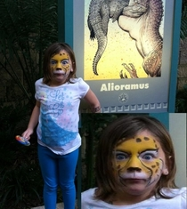 The dinosaur behind her let out a loud roar just as I took the picture