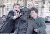 The great-great-great grandchildren of Dickens take a selfie with him on his nd birthday
