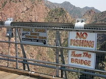 The highest suspension bridge in the world Royal Gorge Bridge in Canon City Colorado which is  feet above the water has this sign warning off would-be anglers