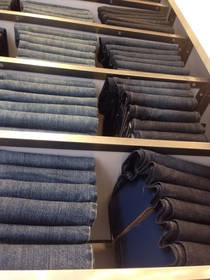 The jeans on the upper shelves are a sham