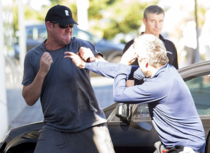 The most Aussie photo of billionaire James Packer fighting another billionaire in a parking lot