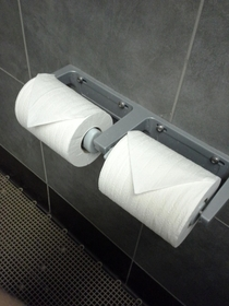 The rolls are neatly folded like this every morning when I come into work Thank you hardworking stranger Now if youll excuse me Im going to rip it off and smear shit on it