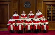The uniforms for the Canadian Supreme Court makes the judges look like Santa Clauses in training