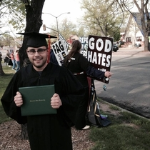 The Westboro Baptist Church came to protest my graduation yesterday so I decided that the best way to react to this was by getting a nice graduation photo with them in my cap and gown