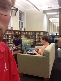 Theres a guy studying for finals drinking beer shirtless in the library