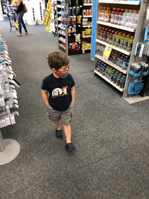 Theres something about my son walking the aisles in a mask with his hands in his pockets that makes it seem like hes the regional manager checking it out