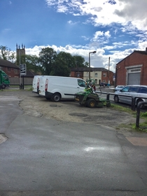 They couldnt all fit in two vans so one guy drove the mower to the cafe