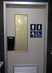 This bathroom caters for men women people in wheelchairs AND one legged babies What a world we live in