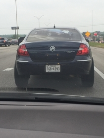 This dude has a picture of himself with his car across the entire back window of his car