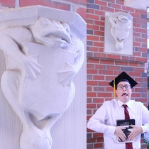 This frog statue always made me laugh So I imitated it for my grad pics