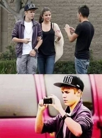 This guy made Justin Bieber take a picture of him and Selena Gomez and then walked away I want to give that guy a hug