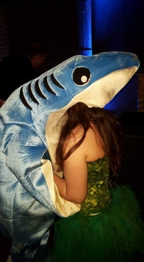 This guy was dressed as Katy Perrys shark in a party an this is him kissing a girl
