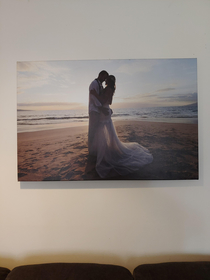 This is a picture of two of my best friends on their wedding day in Hawaii They got divorced shortly after and now I display it as hotel art in my living room