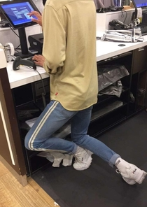 This is how my friends coworker stands at his desk so he doesnt have to hunch over