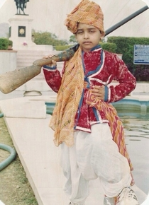 This is my old school pic At age  rocking an old Indian military outfit with some Adidas kicks LOL