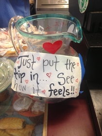 This is the tip jar at a little caf staffed entirely by women who dont wear bras
