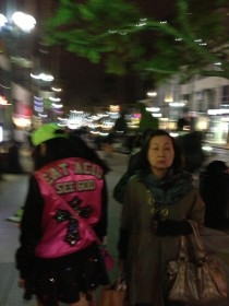 This Japanese woman and her daughter were walking around downtown With a FANTASTIC jacket