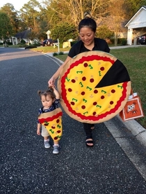 This kid as a teeny slice of pizza