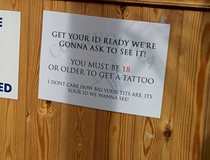This Local tattoo studio has a sign at the reception counter