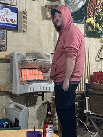 This picture of this motheramp trying to heat up his cold pizza by standing next to our space heater in the garage made my fiancs poker night completely worth it even though he lost money