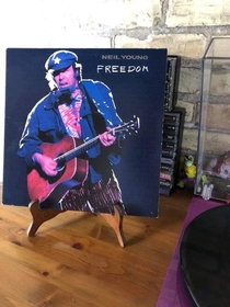 This record stand makes it look like Neil Young has peg legs