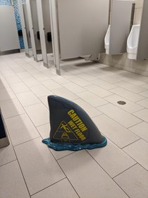 This wet floor sign at the Toronto aquarium