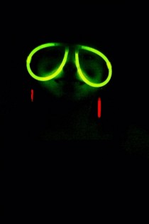 Took a photo of my daughter wearing glow in the dark glasses and it somehow made her look like a grinning sloth