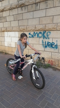 Took a pic of my kid on her new pimped up bike didnt pay attention to the graffiti in the background