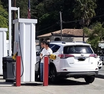 Tourist in Calistoga struggling hard at the gas pump