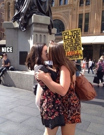 Two lesbians protesting a protester