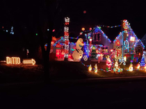 two of my neighbors christmas lights