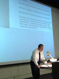 University professor reading his own teaching reviews to the class