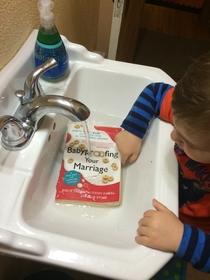 Walked in the bathroom to find our precious child washing a book he found