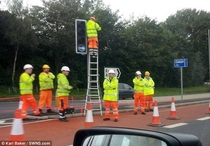 We finally have answer to one of the most important questions of all time - How many road workers does it take to change a lightbulb
