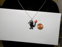 Well I sculpted that guys shitty Charmander tattoo into a necklace and I know EXACTLY why Because Im a filthy procrastinator thats why